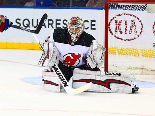 Devils goaltender Keith Kinkaid (1) makes a save against
