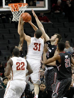 Iowa State  forward Georges Niang puts up a shot against South Carolina forward Michael Carrera.