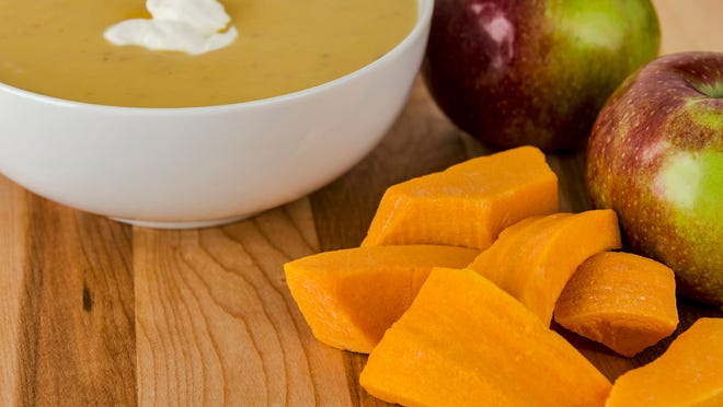 Butternut squash and apples are used to make soup.