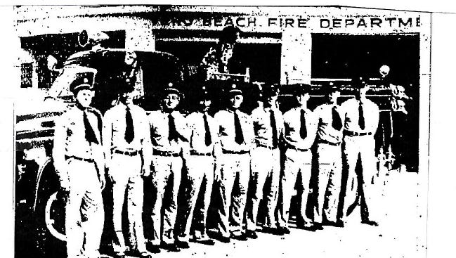 It's fire prevention week in the city and county. Vero Beach's nine regular firemen include, (from left) Guy Sullivan, chief; Forrest Smith, lieutenant; Eugene Ledford, captain; John Allen, fireman; Lynn Shaw, lieutenant; Robert Lewis, fireman; Paul Smith, fireman; Dallas Jones, fireman; Jim Corice, fireman. Mascot Smokey, a pure-bred Dalmatian, is on the truck.