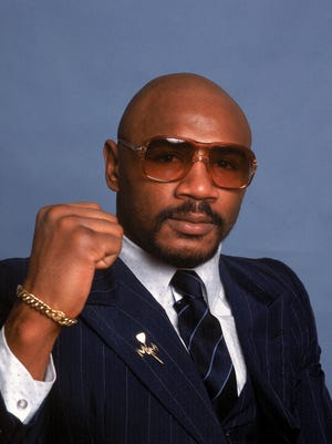 """In this 1982 file photo, middleweight boxing great Marvin Hagler's title reign ended with a split-decision loss """"sugar"""" Ray Leonard in 1987."""