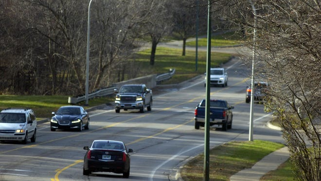 Birmingham officials restriped a section of West Maple from four lanes down to three as part of a trial study.