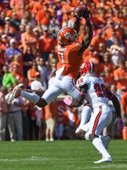 Clemson wide receiver Mike Williams (7) catches a pass over North Carolina State cornerback Jack Tocho (29) during the 1st quarter on Saturday, October 15, 2016 at Clemson's Memorial Stadium.