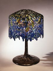 Tiffany Studios, New York, Clara Discoll, designer, Wisteria Library Lamp, ca. 1901, leaded glass, bronze.