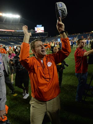 Clemson head coach Dabo Swinney thanks the Clemson fans after the Tigers' 42-35 win over Virginia Tech the ACC Championship at Camping World Stadium in Orlando on Saturday, December 3, 2016.