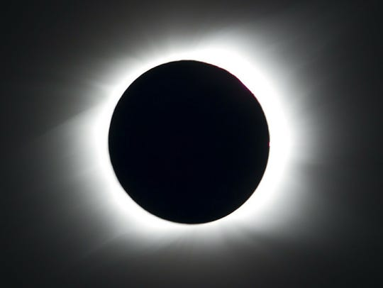 The sun is seen partially covered by the moon on Easter