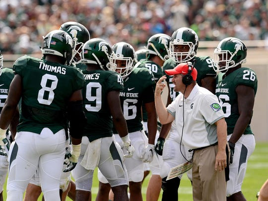 Michigan State co-defensive coordinator Mike Tressel talks to the defense during the fourth quarter of the Spartans 30-10 win over Central Michigan in September at Spartan Stadium.