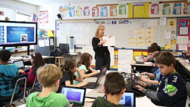 Fourth-grade teacher Lorraine McDermott goes over a class assignment at Todd Elementary School in Briarcliff .