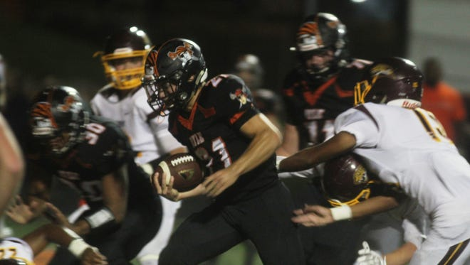 Ryle RB Jacob Chisholm looks for running room.