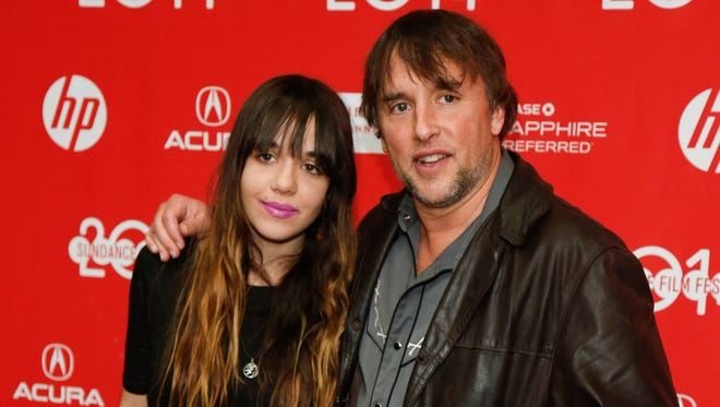 """Richard Linklater, right, and daughter Lorelei Linklater, at the premiere of the film """"Boyhood"""" during the 2014 Sundance Film Festival, in Park City, Utah on Jan. 19, 2014. The 2015 best picture Oscar nominee film, first premiered at the independent film festival."""