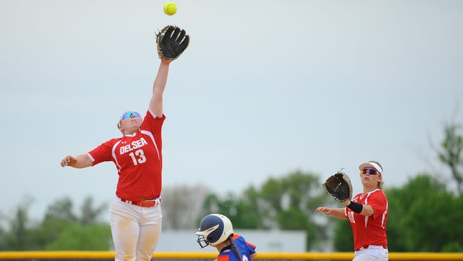 Delsea's Diana Parker jumps to make a catch in Saturday's Hammonton Invitational final. Parker,a junior who will play at Campbell University, earned her 100th hit last week with a home run against Triton.
