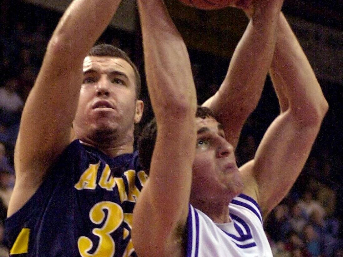 Ed Nelson of St. Thomas Aquinas, left, battles with Mike Orfini of Gonzaga College High for a rebound in the 2000 STOP-DWI Holiday Classic.