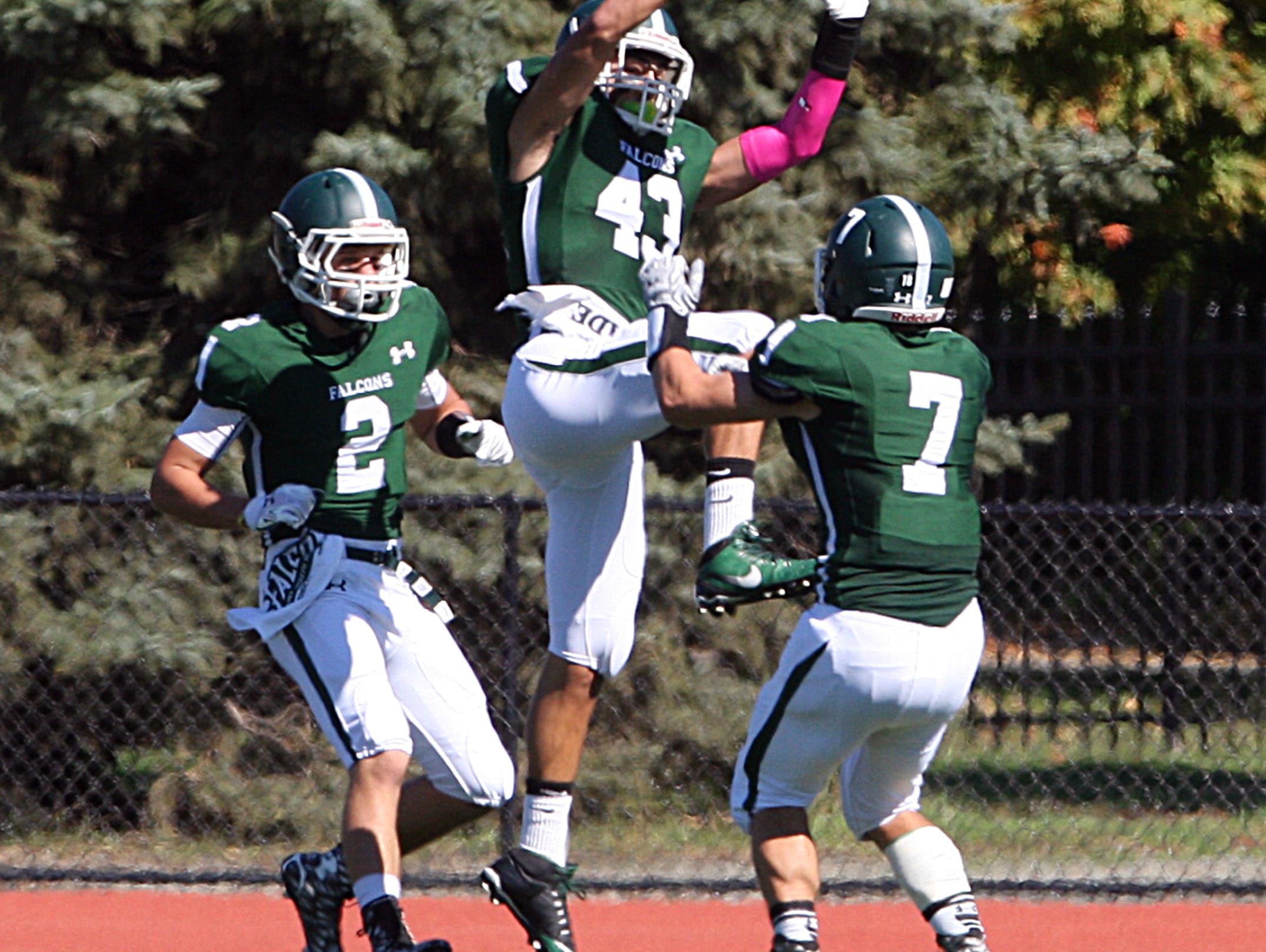 Action photos from the Perth Amboy High School at St. Joseph football game held at St. Joseph's new turf field in Metuhen on Saturday October 10, 2015. Here St. Joseph's # 43 (center)Joe Papa celebrates with team mates his 1st half touchdown.