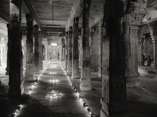 """Kanchipuram #638,"" by  Kenro Izu, depicts the interior of a sacred space in India."