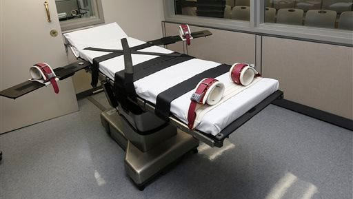 This Oct. 9  file photo shows the gurney in the the execution chamber at the Oklahoma State Penitentiary in McAlester, Okla. The botched April execution of an Oklahoma inmate and other troubling ones in Ohio and Arizona this year gave capital punishment opponents a flicker of hope that the most pro-death penalty parts of the country might have a change of heart. They didn't.