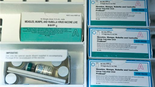 This file photo, shows boxes of the measles, mumps and rubella virus vaccine (MMR) and measles, mumps, rubella and varicella vaccine inside a freezer at a doctor's office in Northridge, Calif. While much of the attention in the ongoing measles outbreak has focused on student vaccination requirements and exemptions, less attention has been paid to another group in the nation's classrooms: Teachers and staff members, who by and large are not required to be vaccinated