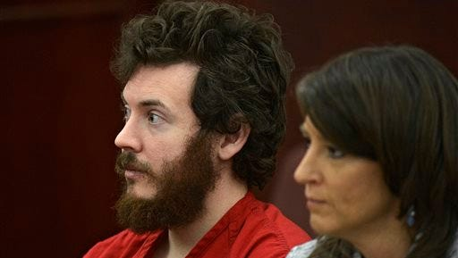 FILE - In this March 12, 2013, file photo, James Holmes, left, and defense attorney Tamara Brady appear in district court in Centennial, Colo., for his arraignment. Prosecutors are methodically building a case that Holmes knew right from wrong when he planned and carried out the deadly Colorado theater shooting, hoping to convince jurors that he should be convicted and executed and not sent to a mental hospital. (RJ Sangosti/The Denver Post via AP, Pool, File)