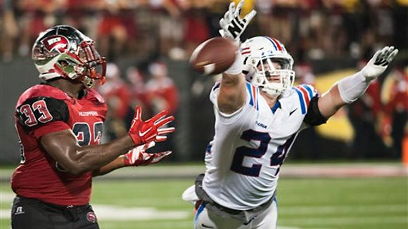 Western Kentucky running back Leon Allen (33) makes a catch while defended by Louisiana Tech linebacker Nick Thomason (24) during Western Kentucky's 41-38 win over Louisiana Tech in an NCAA college football game Thursday, Sept. 10, 2015, in Bowling Green, Ky. (Austin Anthony/Daily News via AP)