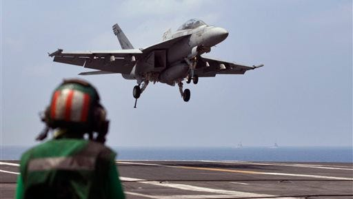 FILE - This Oct. 17, 2015 file photo shows a U.S. Navy fighter jet approaching to land on the U.S. Navy aircraft carrier USS Theodore Roosevelt during Exercise Malabar 2015 about 150 miles off Chennai, India. The U.S. Pacific Fleet is smaller than it was in the 1990s, helping fuel a debate about whether the U.S. has enough ships to meet challenges posed by fast-growing and increasingly assertive Chinese naval forces. (AP Photo/Arun Sankar K., File)