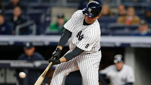 New York Yankees Brian McCann hits a first-inning, two-run double off Houston Astros starting pitcher Collin McHugh in a baseball game in New York, Wednesday, April 6, 2016. (AP Photo/Kathy Willens)