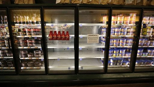 Shelves sit empty of Blue Bell ice cream at a grocery store in Dallas, Tuesday, April 21, 2015. (AP Photo/LM Otero)