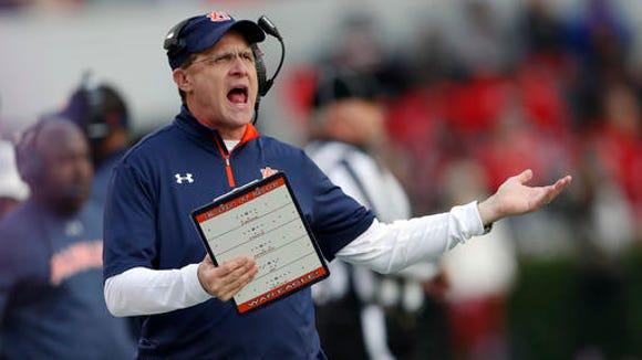 Auburn head coach Gus Malzahn yells at an official