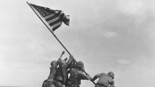 FILE - In this Feb 23, 1945 file photo, U.S. Marines of the 28th Regiment, 5th Division, raise the American flag atop Mt. Suribachi, Iwo Jima, Japan. This iconic image is included in Time magazine's most influential images of all time, released Thursday, Nov. 17, 2016, through a new book, videos and a website, Time.com/100photos.