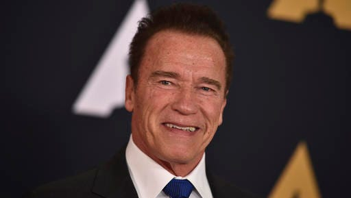 "FILE - In this Nov. 12, 2016 file photo, Arnold Schwarzenegger is seen in Los Angeles. President Donald Trump is seeking prayers for Schwarzenegger over ratings for ""Celebrity Apprentice,"" the show Trump once hosted. Addressing the National Prayer Breakfast in Washington, Thursday, Feb. 2, 2017, Trump said ratings went ""right down the tubes"" and the show's been a ""total disaster"" since the actor and former California governor debuted as host last month."