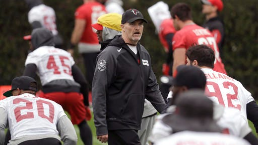 Atlanta Falcons head coach Dan Quinn watches over a practice Friday in preparation for the Super Bowl on Sunday.