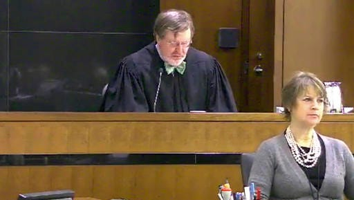 FILE - This March 12, 2013 file still image taken from United States Courts shows Judge James Robart listening to a case at Seattle Courthouse in Seattle. Online abuse of Robart, who temporarily derailed President Donald Trump's travel ban, has raised safety concerns, according to experts who are worried that the president's attacks on the judiciary could make judges a more inviting target.