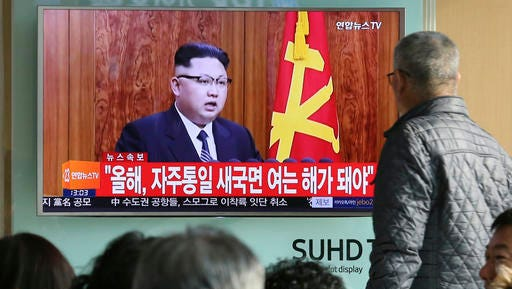 "FILE - In this Sunday, Jan. 1, 2017 file photo, South Koreans watch a TV news program showing North Korean leader Kim Jong Un's New Year's speech, at the Seoul Railway Station in Seoul, South Korea. North Korea reportedly fired a ballistic missile early Sunday, Feb.  12, 2017, in what would be its first such test of the year and an implicit challenge to President Donald Trump's new administration. Details of the launch, including the type of missile, were scant. The letters on the screen read ""New Year for Reunification."""