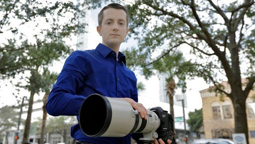 "In this photo taken Feb 9, 2017, Mike Schwarz, sole proprietor of Mike Schwarz Photography, poses for a photo in Tampa, Fla. Schwarz is a self-employed business owner who buys his own health insurance. The subsidized coverage ""Obamacare"" offers provides him protection from life's unpredictable changes and freedom to pursue his vocation, he says."