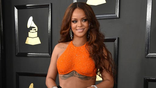 FILE - In this Feb. 12, 2017 file photo, Rihanna arrives at the 59th annual Grammy Awards in Los Angeles. Harvard University will present the singer with the Peter J. Gomes Humanitarian Award on Tuesday, Feb. 28, 2017, during a ceremony on campus in Cambridge, Mass.