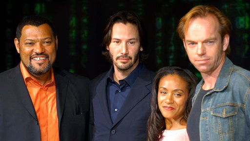 """FILE - In this May 27, 2003 file photo, cast members Laurence Fishburne, from left, Keanu Reeves, Jada Pinkett Smith and Hugo Weaving pose to promote their latest film, """"Matrix Reloaded,"""" the second film from """"The Matrix""""  franchise, in Tokyo. The Hollywood Reporter on Tuesday reported that Warner Bros. is developing a relaunch of the 1999 film, """"The Matrix."""""""