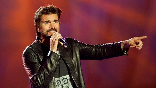 "FILE - In this Dec. 11, 2015 file photo, Colombian singer Juanes performs during the 40 Principales Awards in Madrid, Spain. Juanes has written, ""Goodbye For Now,"" his first English song for his upcoming visual album."