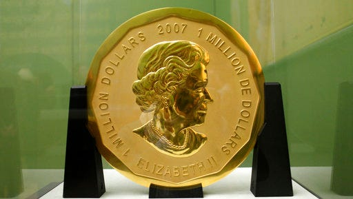 """FILE - The Dec. 12, 2010 file photo shows the gold coin 'Big Maple Leaf' in the Bode Museum in Berlin. The 100-kilogram (220 pound) gold coin disappeared from the museum. Berlin police have published pictures of the tools used to steal a 100-kilogram (221-pound) gold coin stolen from a city museum as they scramble to track down the thieves Friday March 31, 2017. Officials have said that at least two burglars broke into the Bode Museum early Monday,  using a ladder to climb to a window from elevated railway tracks. They grabbed the """"Big Maple Leaf"""" coin, worth some $4.5 million and loaded it onto a wheelbarrow."""