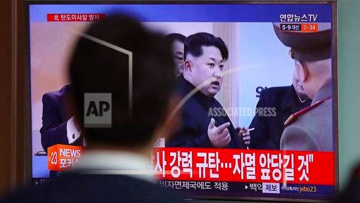 """A man watches a TV news program showing a file footage of North Korean leader Kim Jong Un while at a train station in Seoul, South Korea, Wednesday, April 5. North Korea fired a ballistic missile into its eastern waters Wednesday, U.S. and South Korean officials said, amid worries the North might conduct banned nuclear or rocket tests ahead of the first summit between President Donald Trump and his Chinese counterpart Xi Jinping. The letters read on top left """"North Korea fired a ballistic missile."""""""