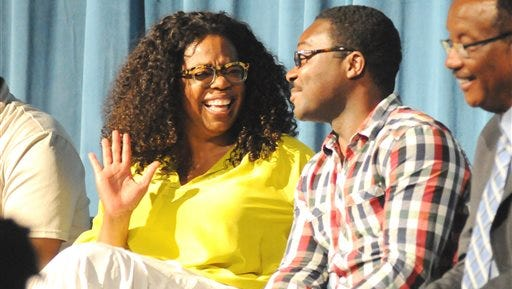 """Oprah Winfrey shares a laugh with actor David Oyelowo during a town hall meeting about the upcoming movie """"Selma"""" in Selma, Ala. Winfrey will play a supporting role in the independent film, and Oyelowo will portray the Rev. Martin Luther King Jr., who led voting rights protests in the west Alabama in 1965."""