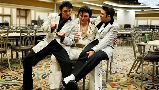 Daniel Jenkins, from left, Tyler James and Jacob Roman joke around during the Las Vegas Elvis Festival in Las Vegas. The three, along with other Elvis tribute artists, performed in a competition at the convention.