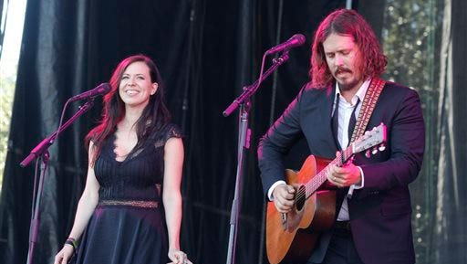 Paul White, right, and Joy Williams of The Civil Wars perform at the Austin City Limits Music Festival, in Austin, Texas. Williams and White issued a statement on their website Tuesday, Aug. 5, 2014 announcing the decision to split, which comes nearly two years after the duo pulled out of a world tour over irreconcilable differences. The duo met on a songwriting project for a put-together country act and had instant chemistry as songwriters. Their self-titled first album went gold and they won four Grammy Awards.