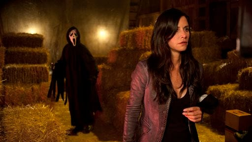 """In this file publicity image released by The Weinstein Company, Courteney Cox appears in a scene from the horror film """"Scream 4."""" MTV announced Tuesday  that it is turning """"Scream, """"the horror movie franchise, into a television series. The goal is to put 10 episodes on the air starting next October."""