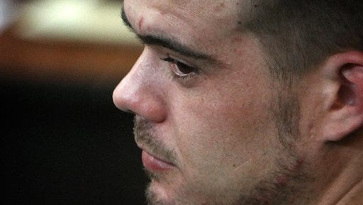 FILE - In this Jan. 13, 2012 file photo, Joran van der Sloot sits in the courtroom before his sentencing at San Pedro prison in Lima, Peru. Van der Sloot's lawyer, Maximo Altez, said Wednesday, May 14, 2014, the 26-year-old Dutchman and his Peruvian fiance have nearly completed legal arrangements to wed. He says the future Mrs. van der Sloot, Leydi Figueroa, is five months pregnant with a boy. (AP Photo/Karel Navarro, File)
