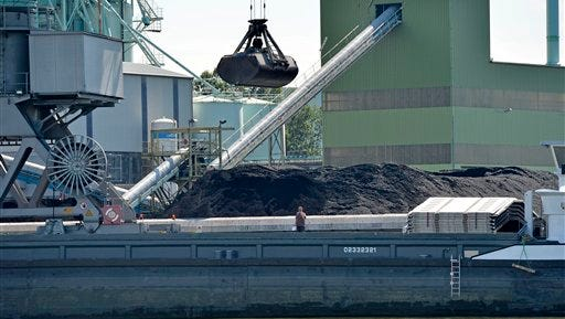 Coal is unloaded at the Trianel power plant in Luenen, Germany, Thursday, July 24, 2014. The 750-megawatt power plant relies completely on coal imports, about half from the U.S. Soon, all of Germany's coal-fired power plants will be dependent on imports, with the country scheduled to halt all coal mining in 2018 when government subsidies end.  As the Obama administration weans the U.S. off dirty fuels blamed for global warming, energy companies have been sending more of America?s unwanted energy leftovers to other parts of the world, where they could create even more pollution. (AP Photo/Martin Meissner)
