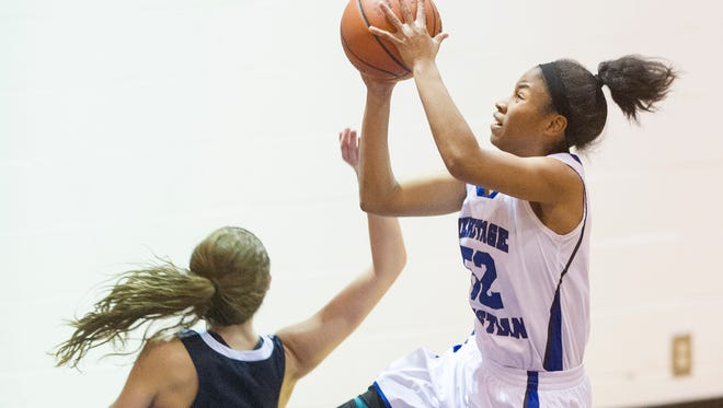 Heritage Christian High School junior Tyasha Harris (52) takes the ball to the basket off a fast break to score during the second half of action. Heritage Christian High School hosted Roncalli High School in girls' varsity basketball action, Thursday, Dec. 4, 2014. Heritage Christian defeated Roncalli 62-49.
