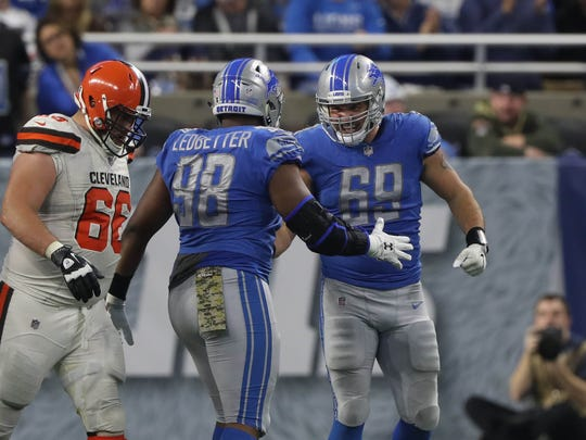 Detroit Lions' Jeremiah Ledbetter and Anthony Zettel celebrate a sack in the fourth quarter against the Cleveland Browns, Sunday, Nov. 12, 2017 at Ford Field.