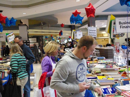 Tables at Laurel Park Place in Livonia were piled high with more than 200,000 used books, DVDs and more during Bookstock.