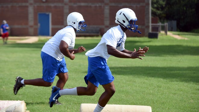 North Forrest High School players run drill during football practice on Tuesday.