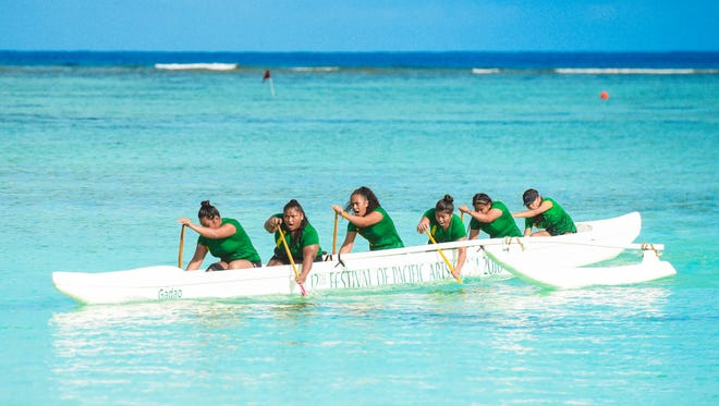 Paddlers of John F. Kennedy High School's Islanders cut their outrigger through the waters of Tumon Bay as they compete in the Independent Interscholastic Athletic Association of Guam and the Guam Kayak and Canoe Federation Paddling series at Matapang Beach on Saturday, April 21, 2018.