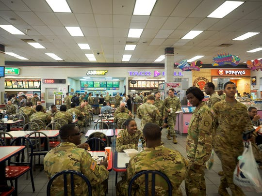 Soldiers based at Camp Humphreys eat lunch at a commissary