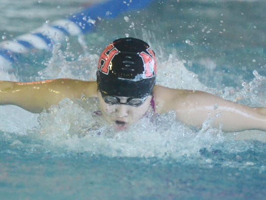 Claire Shin finished second in the butterfly for the Highlanders.